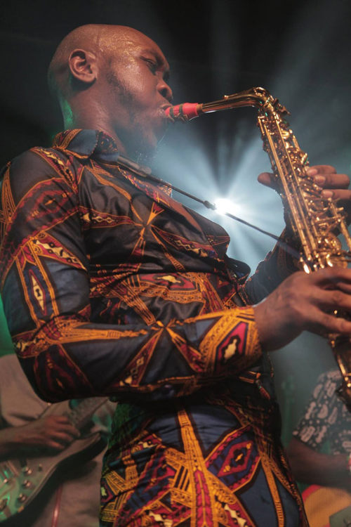 Saxophonist Seun Kuti and his red Syos alto saxophone mouthpiece