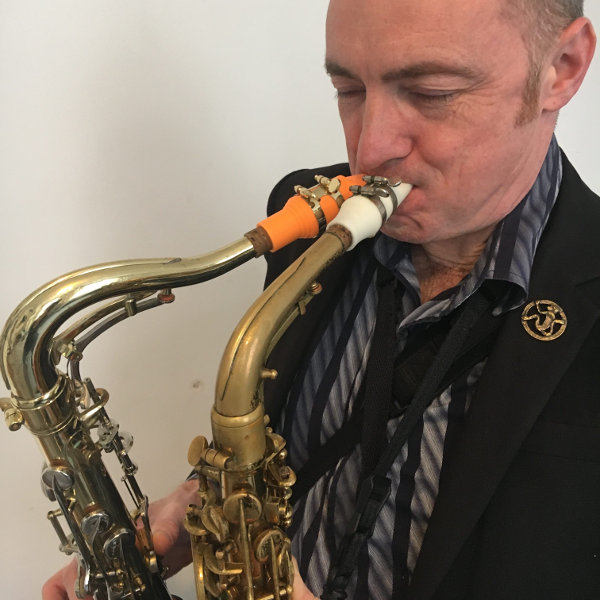 Terry Edwards and his Syos white and orange mouthpieces for alto and tenor saxophones