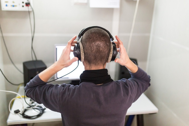 Man is listening sound in a headset