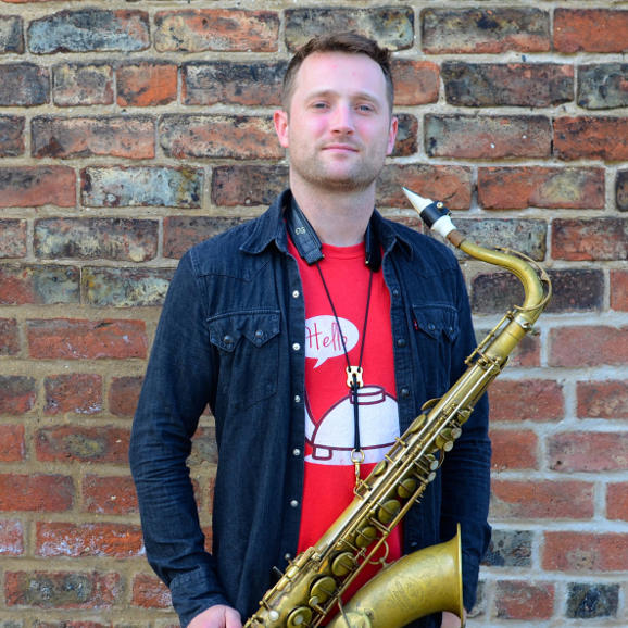 The saxophonist Andrew Cow Scott and his white tenor Syos mouthpiece