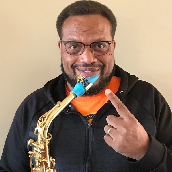 Christopher Burnett plays a Syos mouthpiece on his alto saxophone