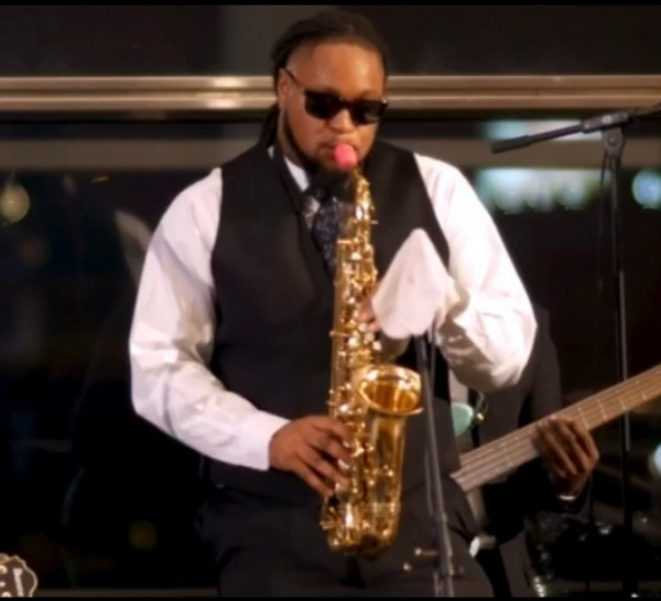 Phillip Mouton plays a Syos mouthpiece on his alto saxophone