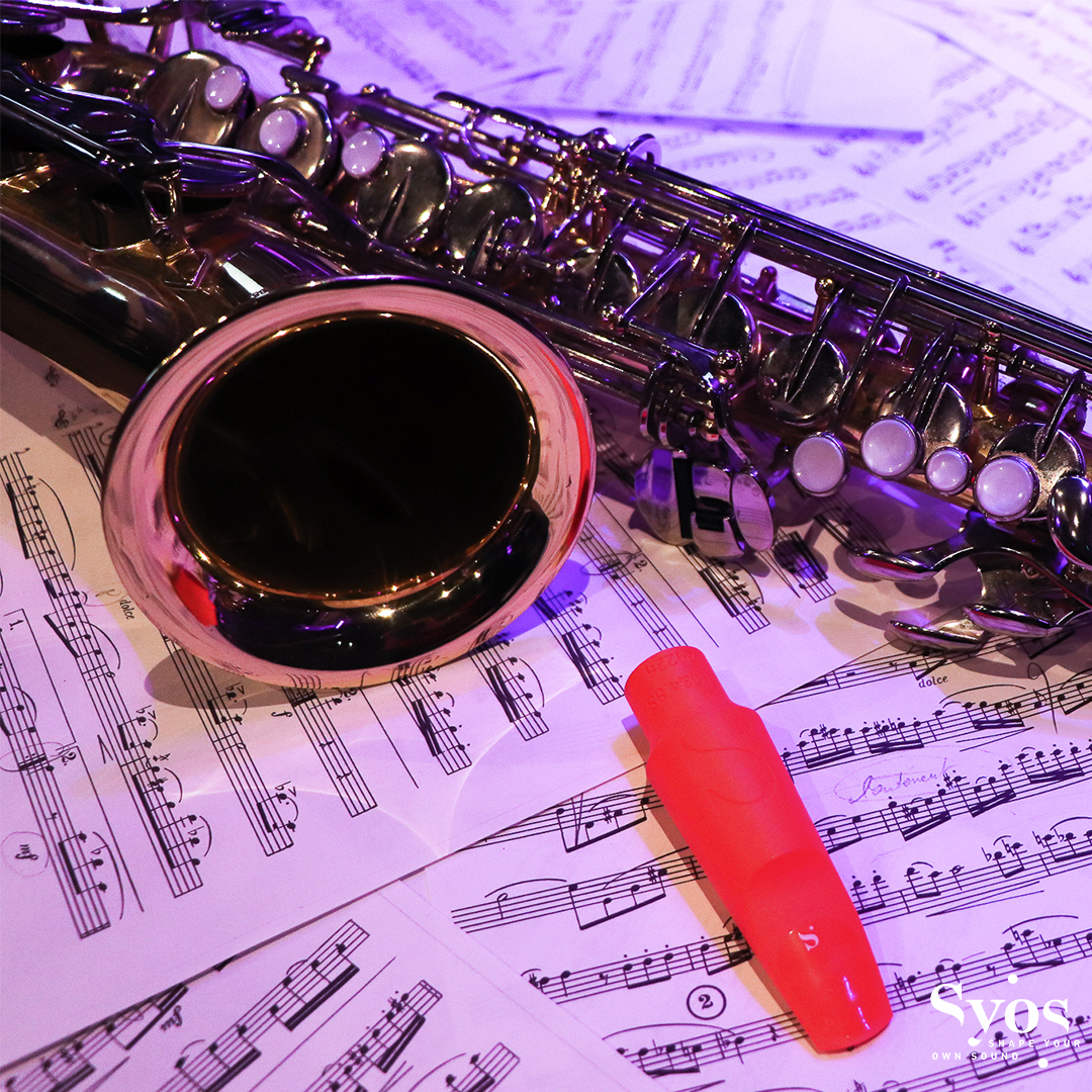 Saxophone, mouthpiece and score sheet