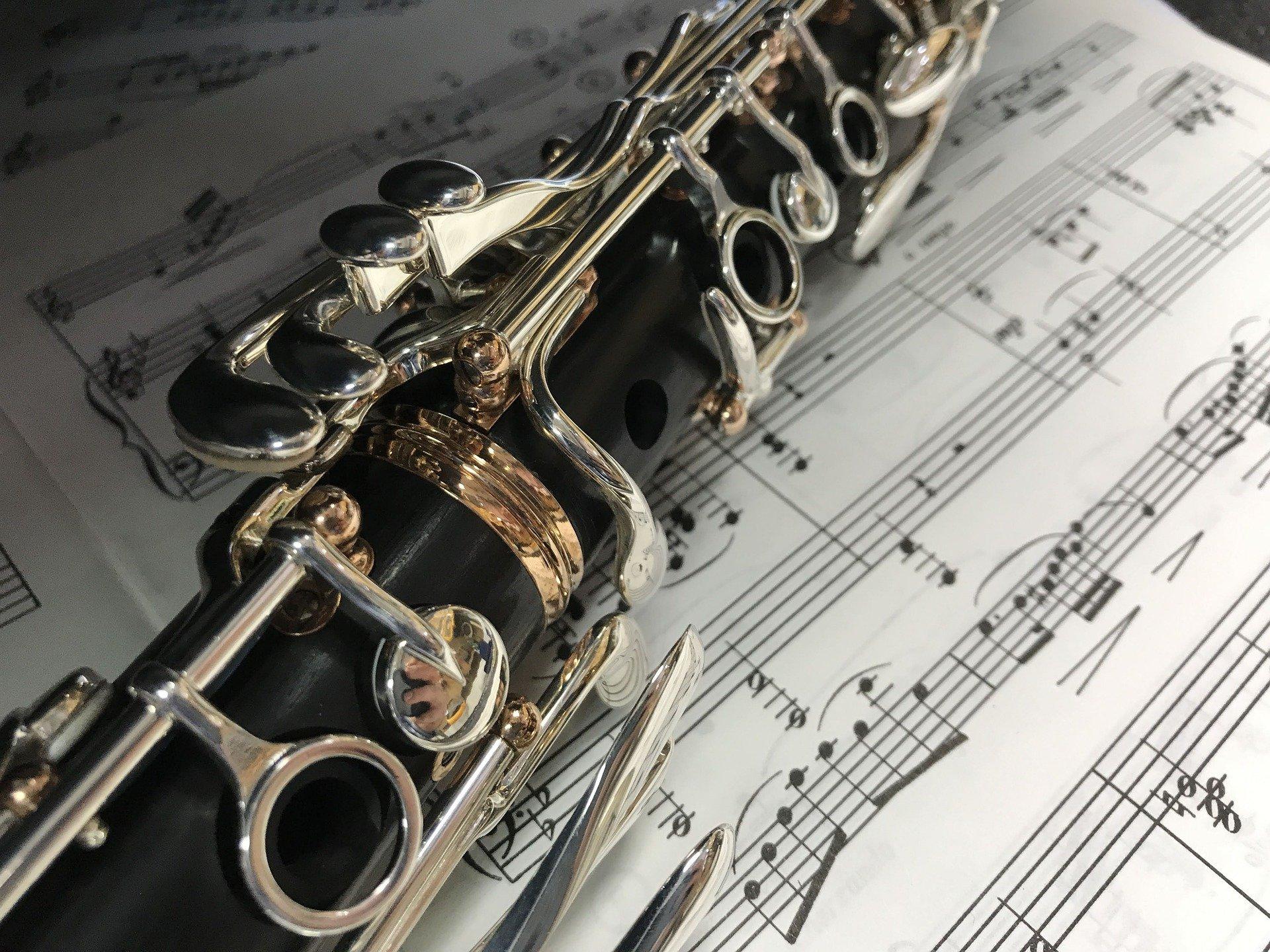 A clarinet laying on a scoresheet